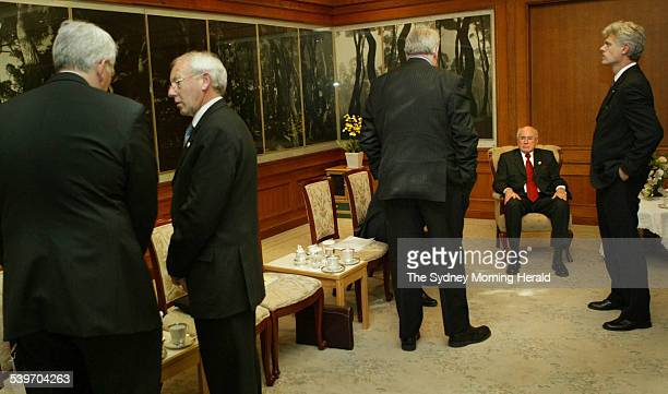 An unhappy Prime Minister John Howard some hours after his bilateral meeting with Singapore's PM Lee Hsien Loong where afterwards in a press...