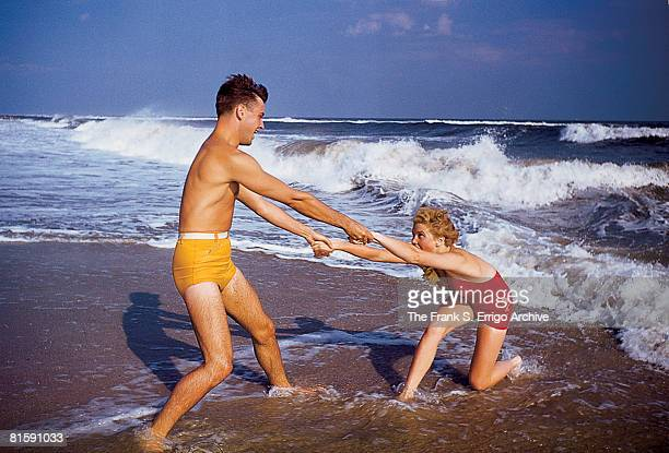 An unidenified couple hold hands as they play in the surf at Jones Beach Long Island New York 1942