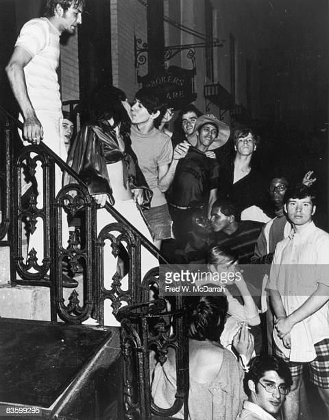 An unidentifed group of young poeple celebrate on a building stoop near the boardedup Stonewall Inn after riots over the weekend of June 27 1969 The...