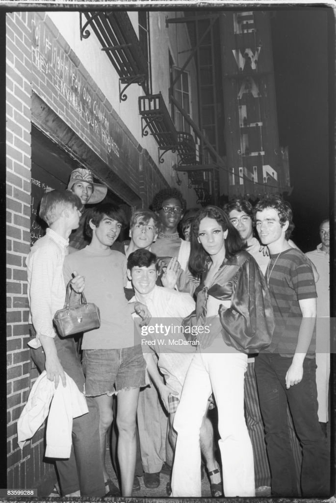 An unidentifed group of young poeple celebrate outside the boarded-up Stonewall Inn (53 Christopher Street) after riots over the weekend of June 27, 1969. The bar and surrounding area were the site of a series of demonstrations and riots that led to the formation of the modern gay rights movement in the United States.