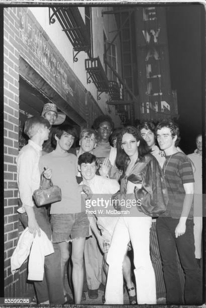 An unidentifed group of young poeple celebrate outside the boardedup Stonewall Inn after riots over the weekend of June 27 1969 The bar and...