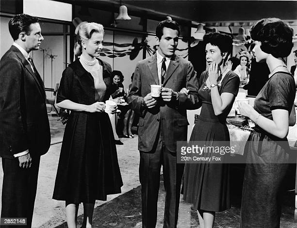 An unidentified actor American actor Hope Lange Irish actor Stephen Boyd American actor Diane Baker and an unidentified actor talk during an office...