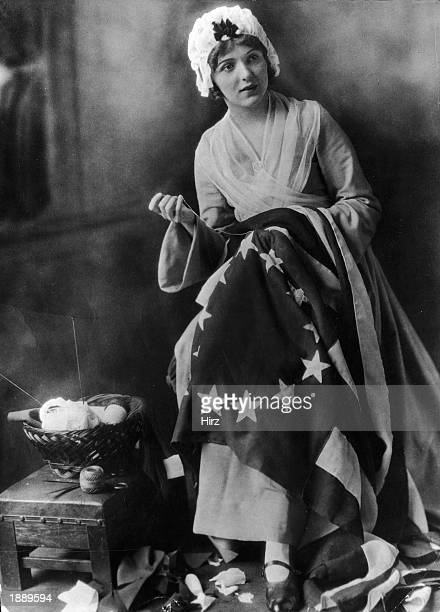 An unidentified actress portrays American seamstress Betsy Ross who was credited with creating the first American flag during the American...
