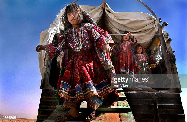 An unidentified Afghan Kuchi nomad child walks down a ramp as other children observe September 4 2002 in Zhare Dasht Afghanistan The Kuchi nomad...