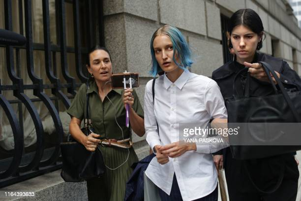 An unidentified alleged victim of deceased financier Jeffrey Epstein walks outside the US Federal Court on August 27 2019 in New York Jeffrey Epstein...