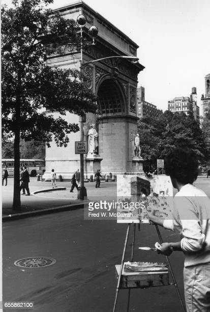 An unidentified artist paints Washington Square Arch during the semiannual Washington Square Outdoor Art Exhibit New York New York Sept 7 1963