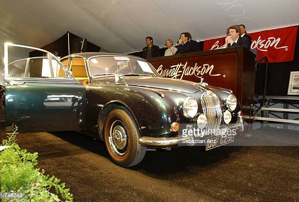 An unidentified auctioneer auctions a 1967 Mark II Jaguar at the Banett-Jackson auction June 14, 2002 in Los Angeles, California.