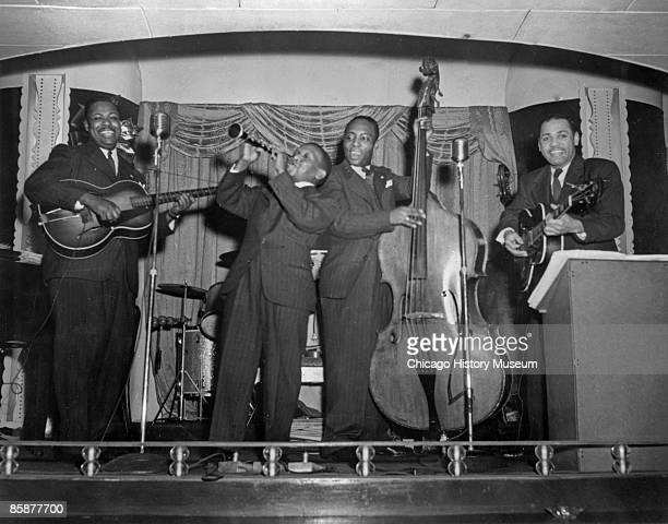 An unidentified band plays some jazz onstage at an unidentified venue in Chicago, ca.1920s. African-American musicians from New Orleans and the...