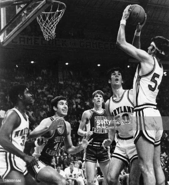 An unidentified basketball player from the Universities of Maryland Terrapins takes a jump shot during a game against the University of South...