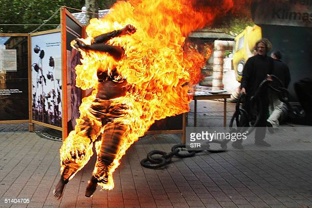 An unidentified Belgian woman of Congolese origin runs in the streets of Luxembourg after setting herself on fire 05 October 2004 after being refused...