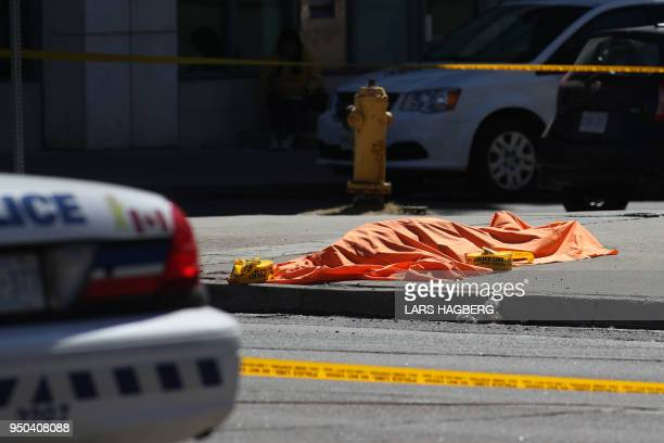 TOPSHOT An unidentified body is seen near the crime scene after a truck hit several pedestrians in Toronto Ontario on on April 23 2018 A man drove a...