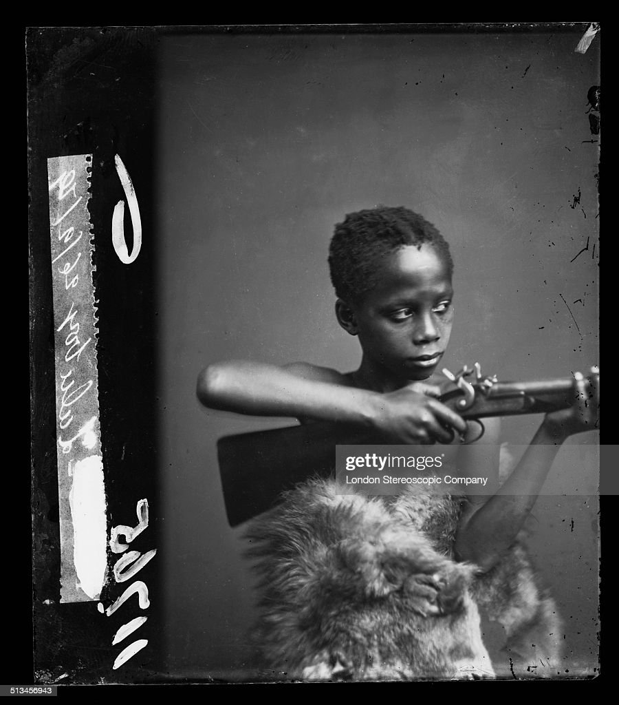 An unidentified boy, referred to as 'Zulu Boy' and possibly as 'Samba Klaas' in London Stereoscopic Company documentation, 26th September 1879. The portrait was taken in the months following the Anglo-Zulu War and may be associated with a related exhibition.