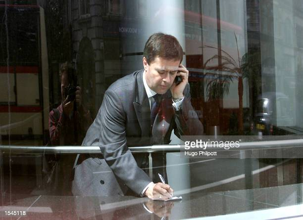 An unidentified businessman uses his cell phone May 22 2002 in London England Cell phone use in the United Kingdom has increased by both business and...