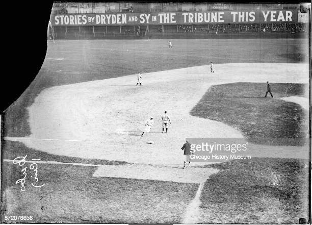 An unidentified Chicago Cubs baseball player runs to third base during a game against the Cincinnati Reds at West Side Grounds Chicago Illinois 1908