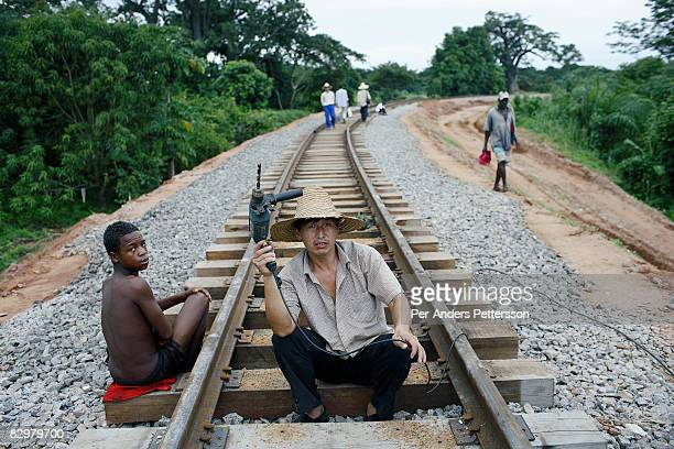 An unidentified Chinese railway worker drills holes on the newly put tracks on April 4 2007 in Dondo about 200 kilometers outside Luanda Angola...