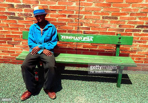 An unidentified construction worker sits on a bench for ''Europeans Only'' on display at the newly opened Apartheid Museum December 19 2001 in...