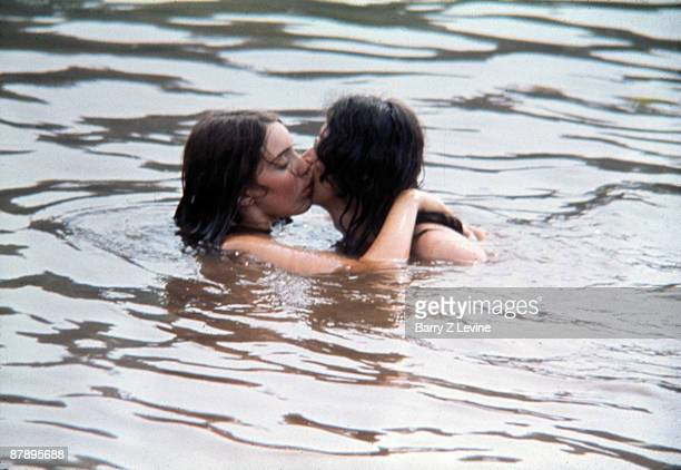 An unidentified couple kiss while mostly submerged under water in a lake on the grounds of the Woodstock Music and Arts Fair in Bethel, New York,...