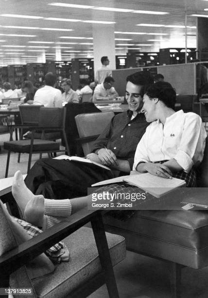 An unidentified couple study together in the University of Michigan library Ann Arbor Michigan 1959