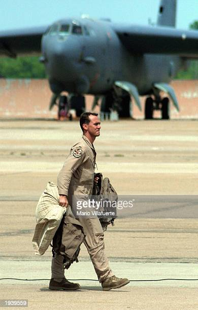 An unidentified crew member of a US Air Force B52 bomber walks to a waiting bus April 18 2003 after arriving at Barksdale Air Force Base Louisiana...