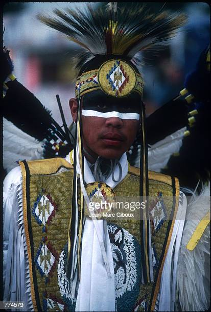 An unidentified dancer enters the arena in a ceremony known as the ''Grand Entry'' August 1 1996 in Pine Ridge South Dakota This tradition announces...