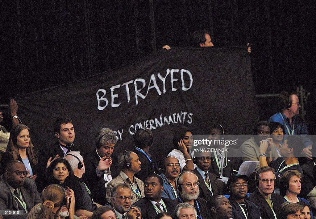 "An unidentified delegate waves a banner reading :"" : News Photo"