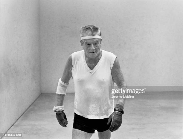 An unidentified elderly handball player drenched in sweat plays a game in a fourwall court Flamingo Park Miami Beach Florida 1977
