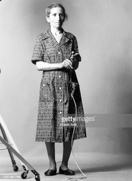 An Unidentified elderly woman takes her own picture for David Attie's book Russian SelfPortraits in July 1976 in Kiev Ukraine