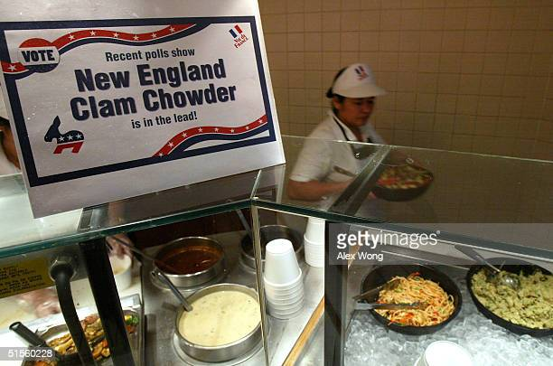 An unidentified employee works at a Vie de France restaurant as a sign shows that New England clam chowder is the customers leading choice of soup...