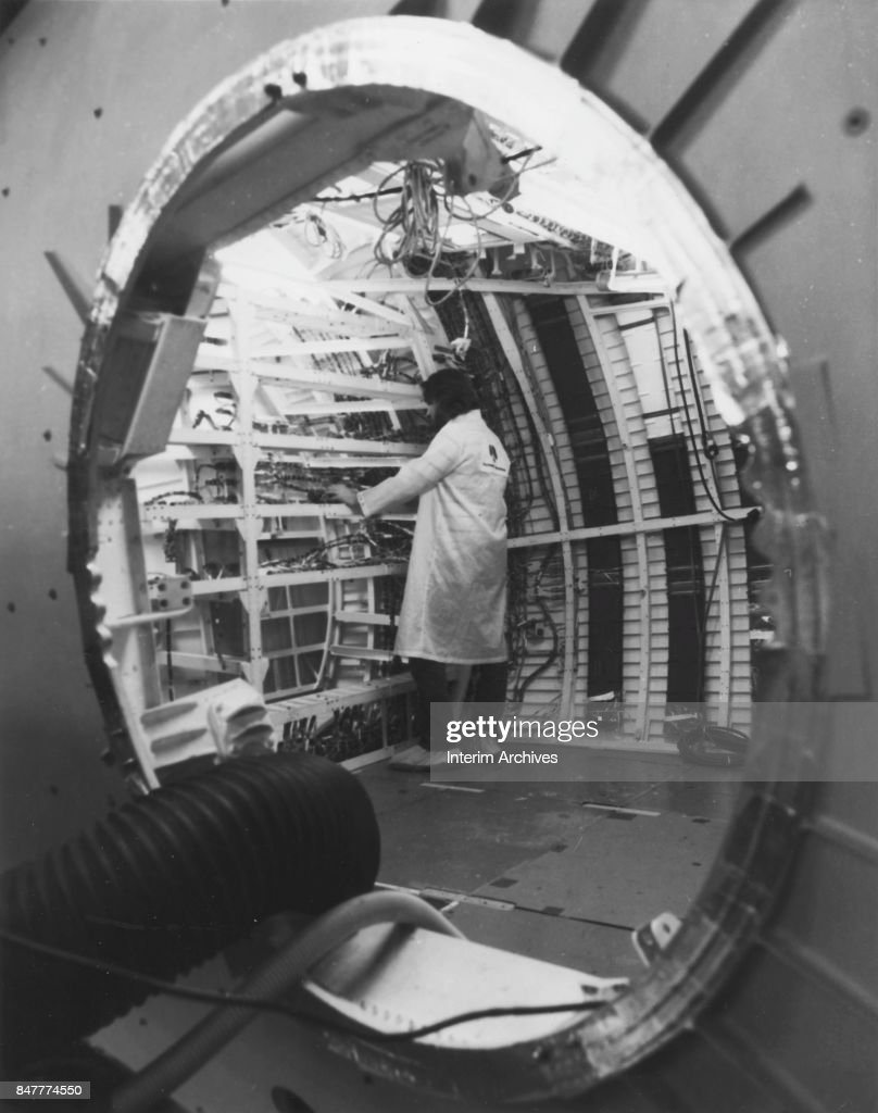 an unidentified engineer inspects wire harness installations in the picture id847774550 engineer at rockwell international pictures getty images