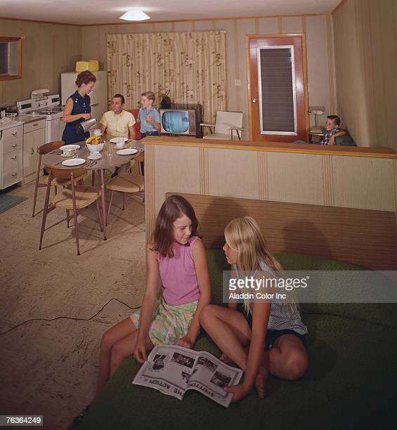 An unidentified family enjoys the amenities offered in an efficiency room at the Monaco Motel Diamond Point New York 1960s In the foreground two...
