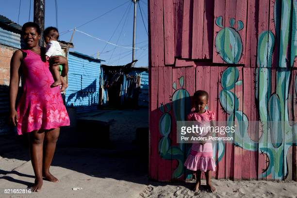 An unidentified family living next to Amandla EduFootball program It was founded by Jakob Schlichtig Florian Zech outside the field in Khayelitsha a...
