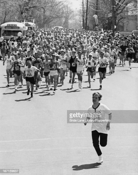 An unidentified female runner leads the field of over a thousand men after jumping into the start of the Boston Marathon in Boston Massachusetts 22nd...