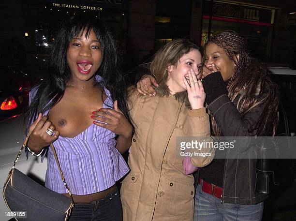 An unidentified French Page 3 model leaves Browns Night Club London March 30 2003
