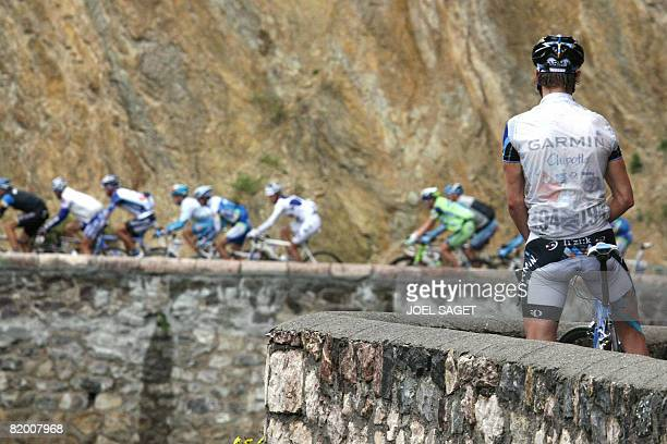 An unidentified Garmin Chipotle rider urinates as the pack rides on July 20 during the 183 km fifteenth stage of the 2008 Tour de France cycling race...