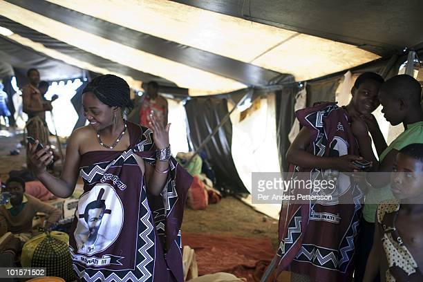 An unidentified girl checks herself in a mirror before a traditional Reed dance ceremony at the Royal Palace on August 31 in Ludzidzini Swaziland...