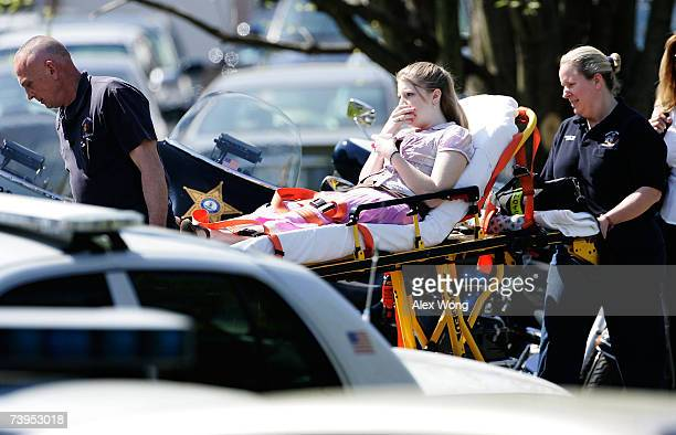 An unidentified girl is carried out by emergency rescuers during the funeral service of Virginia Tech shooting victim Reema Samaha at the Holy...