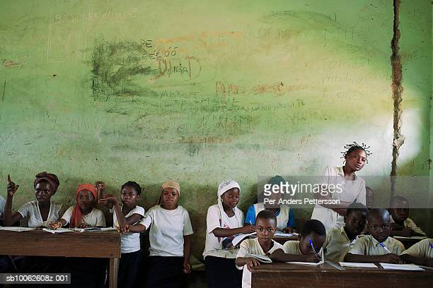 An unidentified girl reads form the black board in a primary school on March 16 2006 in Lukutu Congo DRC Lukutu located along the Congo River is a...