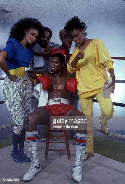 An unidentified group of models surround boxer seated in his corner New York 1980s