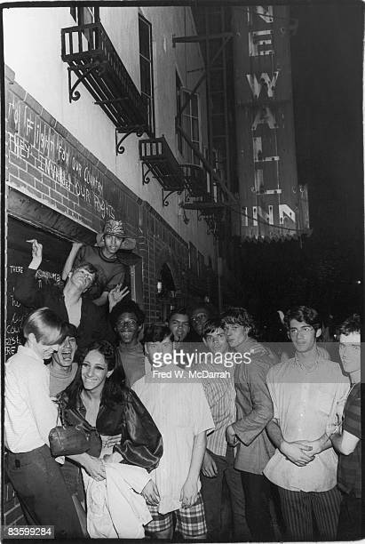 An unidentified group of young people celebrate outside the boarded-up Stonewall Inn after riots over the weekend of June 27, 1969. The bar and...