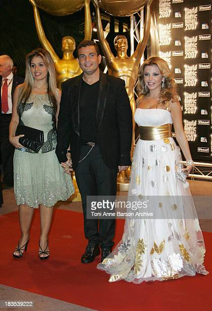 An unidentified guest singers Amr Diab and Razan Al Moughrabi attend the 2007 World Music Awards held at the Sporting Club on November 4 2007 in...