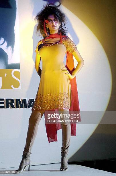 An unidentified Indian model displays a dress from designer Rohit Varma's latest Ammu's collection in Bombay late 26 June 2003 Varma's designs use a...