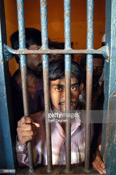An unidentified Indian national stands inside a prison cell November 3 2002 in Karachi Pakistan Approximately 25 Indian nationals were arrested by...