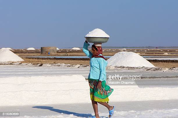 An unidentified Indian woman works collecting salt in the salt pans near Dhrangadhra, Gujarat. India is world's 3rd largest producer of salt, 80% of...