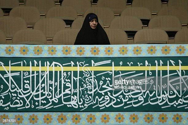 An unidentified Iranian woman attends a Shiite Muslim religious meeting in Tehran 09 October 2003 A 34yearold Iranian nurse convicted of murder was...