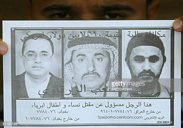 An unidentified Iraqi displays an Arabic leaflet that was airdropped overnight in the flashpoint city of Fallujah west of Baghdad appealing for...