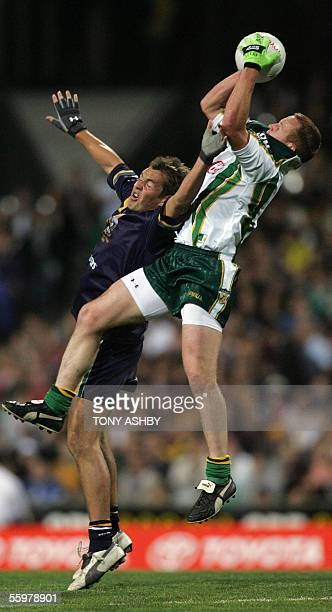 An unidentified Irish forward takes a mark in front of Australian midfielder Luke Hodge during the International Rules football match at Subiaco Oval...