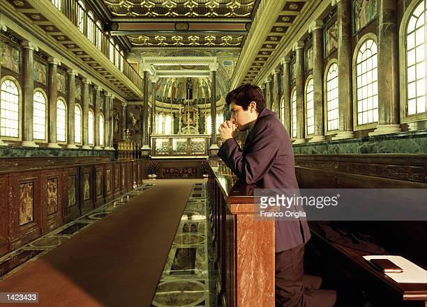 An unidentified lay member of the 'Opus Dei' prays in the chapel of the Blessed Josemaria Escriva de Balaguer the founder of Opus Dei in the prelatic...