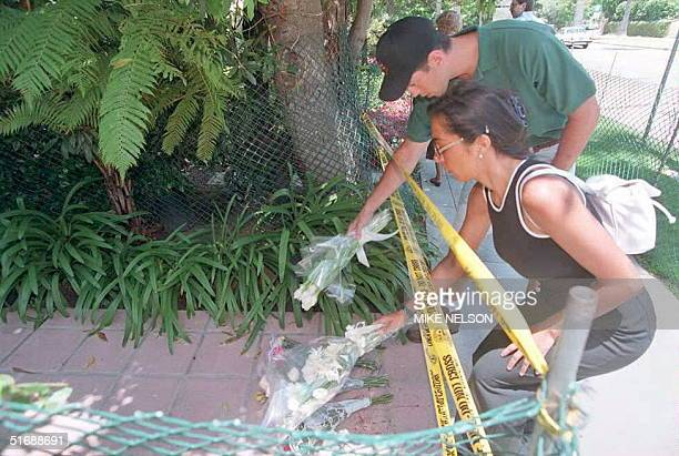 An unidentified man and woman place flowers on the walkway of Nicole Brown Simpson's condominium in Brentwood, California, 12 June. Simpson and her...