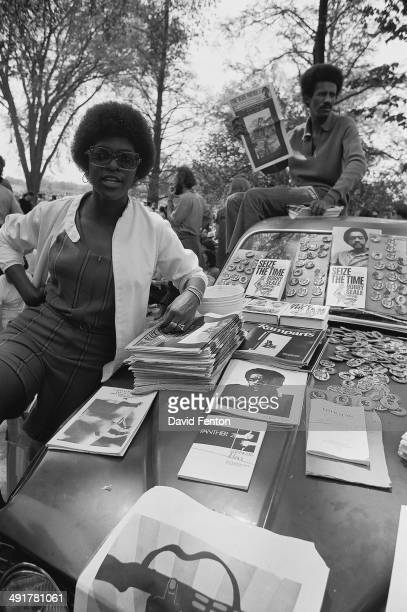 An unidentified man and woman sell Black Panther Party related literature and buttons from the hood of a car New Haven Connecticut May 1 or 2 1970...