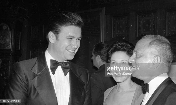 An unidentified man and woman share a laugh with American attorney Roy Cohn at Cohn's birthday party at the Seventh Regiment Armory New York New York...